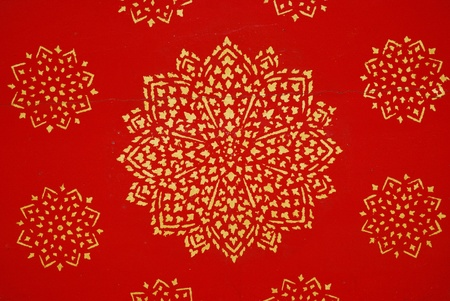 The gold texture on red blackground in thailand photo