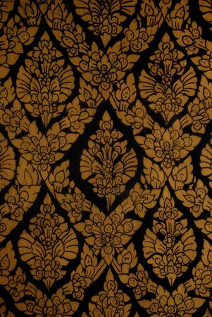 The gold thai texture on black background photo