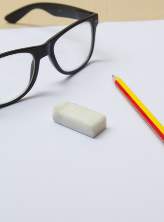crinkly: glasses pencil rubber paper for work Stock Photo