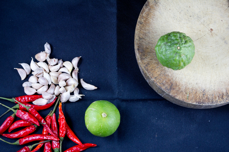 cooking utensil: Thai food herb chili,lime,garlic with kitchen tool