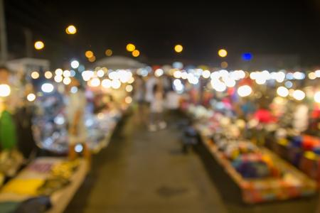 abstract blur focus people shopping at night market at Bangkok Thailand Stock Photo