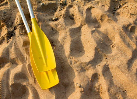 two yellow color Paddle on beach Stock Photo