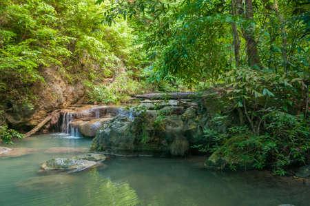 Waterfall in the jungle at Erawan waterfall national park in Kanchanaburi, Thailand