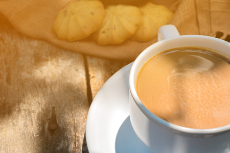 day light: Cup of coffee and cookies on old wooden background Stock Photo