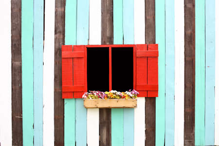 red windos and decorative colorful wood wall Stock Photo