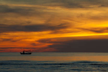 Silhouette of Fishing Boat on sunrise, HuaHin Thailand Stock Photo