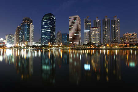 Bangkok skyline by night reflections in the water