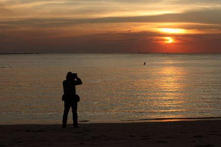 Silhouette cameraman was photographed at bangsan Bech,Chonburi Thailand Stock Photo - 17009873