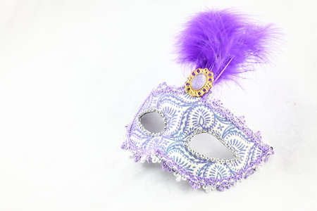 Purple carnival mask over white background Stock Photo
