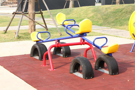 Blue seesaw and yellow seat