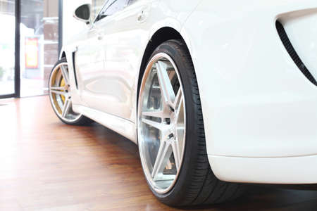 Back wheel of a bright white super car