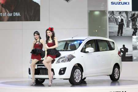 BANGKOK - MARCH 26 : White Suzuki car with Unidentified models on display at The 34th Bangkok International Motor Show 2013 on March 26, 2013 in Bangkok, Thailand.
