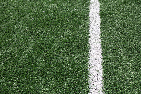 goalline: a green synthetic grass sports field with white line