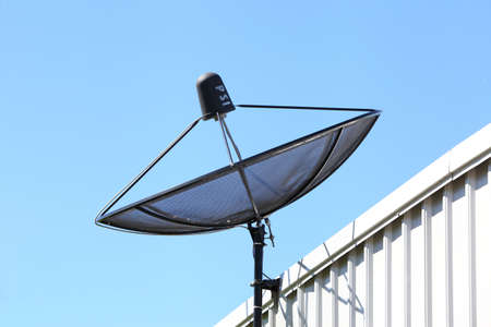 Satellite TV receiver on blue sky background   photo