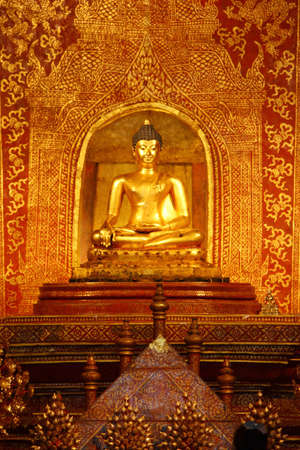 The Main Buddha with golden Thai pattern backgroung in the Wat sing temple Stock Photo