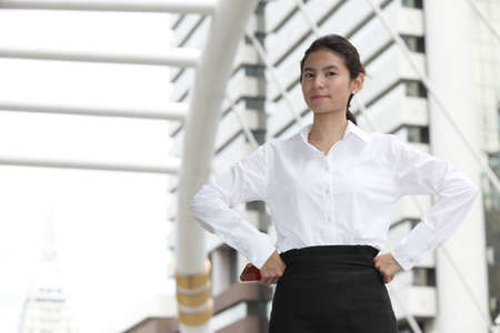 Photo of young businesswoman with arms akimbo photo
