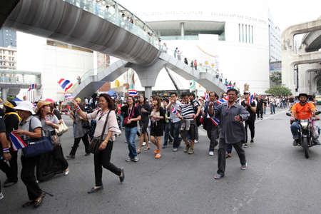 joins: BANGKOK,Thailand - November 11,2013 : A protester joins an anti-government rally walked pass Thanon Rama I  to Ratchadamnoen Road