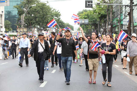 joins: BANGKOK,Thailand - November 11,2013 : A protester joins an anti-government rally walked pass Larn Luang Road  to Ratchadamnoen Road Editorial