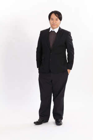 Isolated portrait of fat businessman in black suit Stock Photo