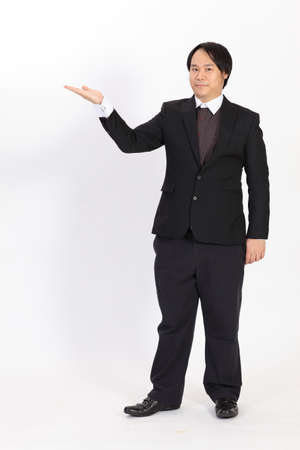 Businessman raising his hand - isolated over a white background photo