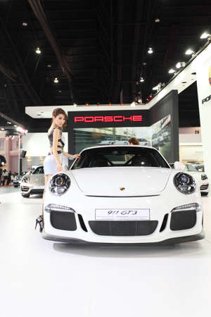 BANGKOK - MARCH 25 : Porsche 911 GT3  car with Unidentified model on display at The 35th Bangkok International Motor Show 2014 on March 25, 2014 in Bangkok, Thailand. Editorial