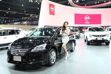 BANGKOK - MARCH 25 : Nissan Sylphy car with Unidentified model on display at The 35th Bangkok International Motor Show 2014 on March 25, 2014 in Bangkok, Thailand.