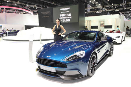 BANGKOK - MARCH 25 : Aston Martin Vanquish coupe car with Unidentified model on display at The 35th Bangkok International Motor Show 2014 on March 25, 2014 in Bangkok, Thailand.