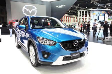 NONTHABURI - March 25: Mazda Mazda2 car on display at The 35th Bangkok International Motor Show on March 25, 2014 in Nonthaburi, Thailand.