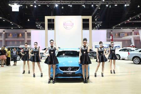 trailblazer: BANGKOK - MARCH 25 : Volvo V40 Trailblazer 2.8L 4WD LTZ car with Unidentified models on display at The 35th Bangkok International Motor Show 2014 on March 25, 2014 in Bangkok, Thailand. Editorial
