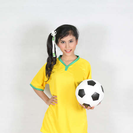 Beautiful woman hold ball with wearing Brazil football top  photo