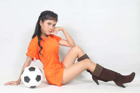Portrait Beautiful woman hold ball wearing football top photo