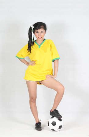 brazil beach swimsuit: Portrait Beautiful woman with wearing Brazil football top  Stock Photo
