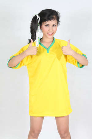 Half Portrait Beautiful woman with wearing Brazil football top,thumbs up photo