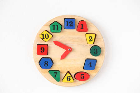 6 12: Colorful wooden and any shape clock on the white wall