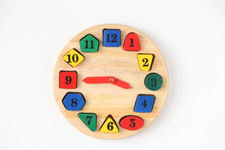 five to twelve: Colorful wooden and any shape clock on the white wall