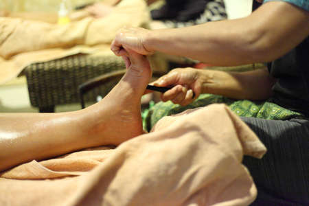 traditional remedy: reflexology foot massage, foot spa treatment