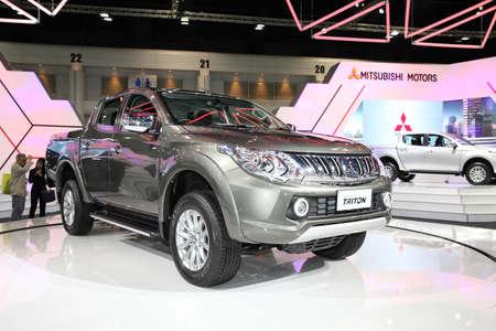 ner: BANGKOK - November 28: Mitsubishi All Ner Triton car on display at The Motor Expo 2014 on November 28, 2014 in Bangkok, Thailand. Editorial
