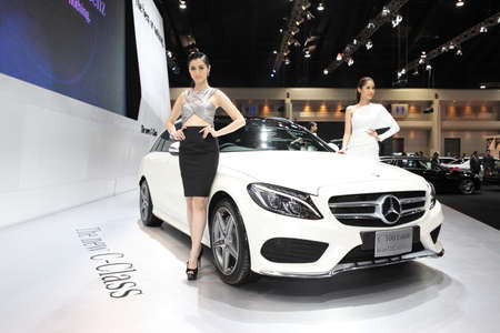 hybrid car: BANGKOK - November 28: Mercedes Benz C 300 Estate BlueTEC HYBRID car with Unidentified model on display at The Motor Expo 2014 on November 28, 2014 in Bangkok, Thailand. Editorial
