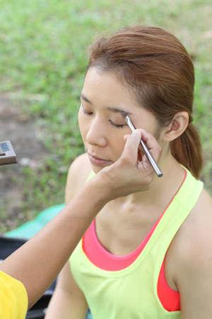 Closeup portrait of a woman having applied makeup by makeup artist Stock Photo