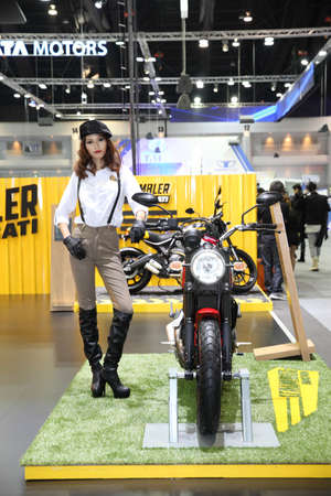 scrambler: BANGKOK - November 28: Ducati Scrambler motorcycle with Unidentified model  on display at The Motor Expo 2014 on November 28, 2014 in Bangkok, Thailand. Editorial