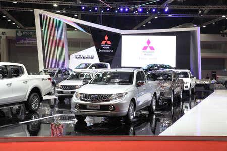 purchasers: BANGKOK - MARCH 25: Showroom of Mitsubishi car  at The 36 th Bangkok International Motor Show on March 25, 2015 in Bangkok, Thailand.