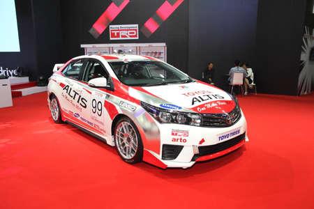 modyfikować: BANGKOK - June 24 : Toyota Altis with modify set with TRD car on display at Bangkok International Auto Salon 2015 on June 24, 2015 in Bangkok, Thailand.