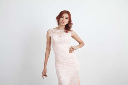 overwhite: half portrait of a beautiful girl in a light pink dress isolated on overwhite background