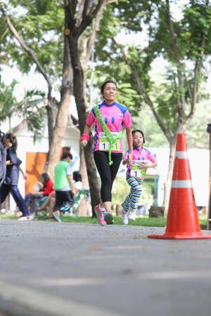 Bangkok - October 23: unidentified runner participates in Ekiden 2015 Marathon relay run fun forward on October 23, 2015 in Bangkok, Thailand Editorial