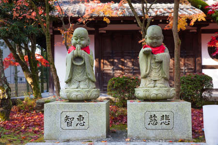 The statues of little Buddhas at a garden. Kyoto, Japan.