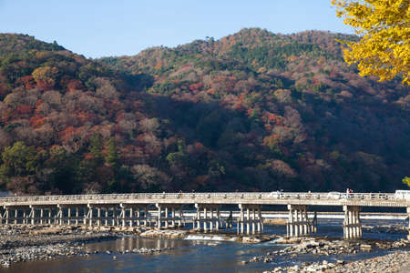 Togetsukyo Bridge in Sunshine Day Autumn, Kyoto, Japan