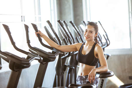 Young beautiful woman smile in gym