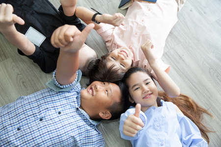 Group Of Happy Young Friends on the floor 版權商用圖片