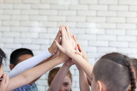 Kids hand assemble as a connection meeting teamwork concept. Teamwork conceptual. Imagens