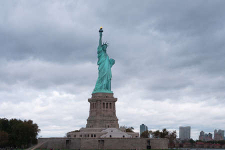 Statue of Liberty on the background of  rainny cloud
